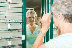 Choosing glasses at the optician Royalty Free Stock Image