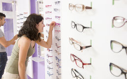 Choosing glasses Stock Image