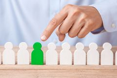 Choosing a good leader worker from the crowd of bad. HR. Man in shirt points finger at good worker stock images