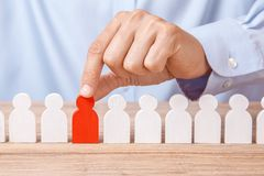 Choosing good leader worker from the crowd of bad. HR. Man in shirt takes good worker`s fingers stock photography