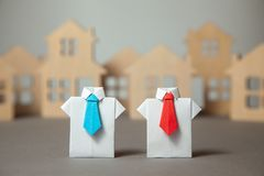 Choosing good Realtor. Realtors in shirt and tie helps to buy or rent. Property stock images