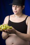 Choosing grapes Stock Photos