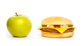 Choosing a healthy apple or an unhealthy burger Royalty Free Stock Images