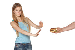 Choosing healthy eating concept. Discontent young female refusing fast food, against white background Royalty Free Stock Photography