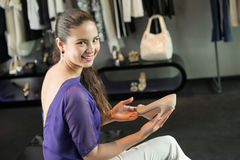 Choosing heels Royalty Free Stock Photos
