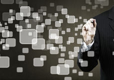 Choosing icon. Businessman hand touching icon of media screen Stock Images