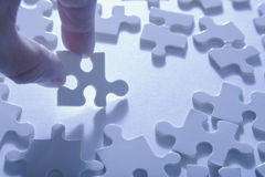 Choosing Jigsaw Piece Stock Image