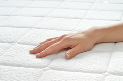 Choosing mattress and bed. Royalty Free Stock Images