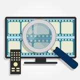 Choosing movies on TV Stock Photo