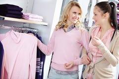 Choosing new pullover Stock Photo