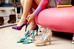 Choosing new shoes stock photography