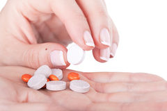 Choosing one pill from pile Stock Images