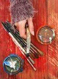 Choosing paint brush Stock Images