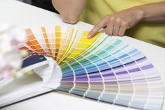 Choosing paint color from tone samples Royalty Free Stock Photo