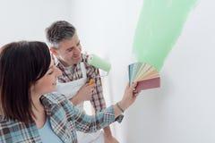 Choosing a paint color Stock Images