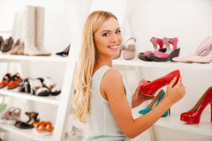 Choosing perfect pair for night out. Royalty Free Stock Photo