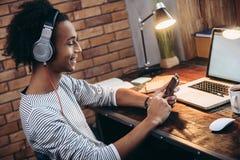 Choosing perfect playlist. Stock Image