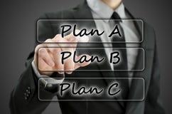 Choosing Plan A. Businessman choosing Plan A on virtual screen Stock Photography