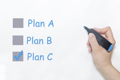 Choosing Plan C on planning process evaluation form stock images