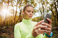 Choosing playlist for jogging Royalty Free Stock Image