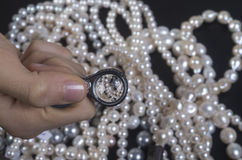 Choosing precious pearl necklaces Stock Photography