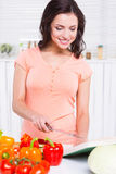 Choosing recipes from the cookbook. Royalty Free Stock Photo