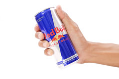 Choosing Red Bull Energy Drink. Held By Male Hand Stock Images