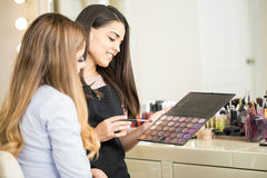 Choosing the right eyeshadow in a salon Royalty Free Stock Photography