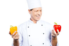 Choosing the right pepper for his meal. Royalty Free Stock Photo