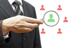 Choosing the right person for hiring. In magnifying glass Stock Photos