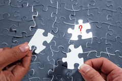 Choosing the right piece of puzzle Royalty Free Stock Photo