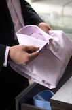 Choosing the right shirt. Close-up of businessman holding a shir Royalty Free Stock Photos