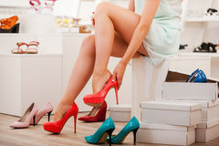 Choosing right shoes for today. Royalty Free Stock Image