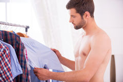 Choosing shirt to wear. Royalty Free Stock Images
