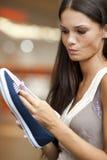 Choosing shoes!. Beautiful young woman choosing shoes Stock Photo