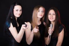 Choosing songs in karaoke Royalty Free Stock Photos