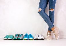 Choosing sports shoes Stock Images