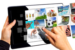 Choosing streaming multimedia on the tablet. Multimedia streaming of the tablet screen with pointing hand. All images coming from my gallery Royalty Free Stock Photography