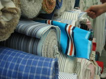 Choosing Textile. Choosing cloth in the textile marketplace Royalty Free Stock Images