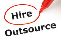 Hire or Outsource with Red Marker. Choosing to Hire instead of Outsource. Hire selected with red marker Royalty Free Stock Images