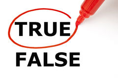 True or False with Red Marker. Choosing True instead of False. True selected with red marker Royalty Free Stock Image