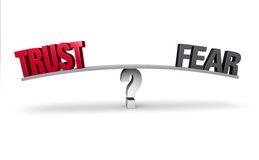 Choosing Between Trust and Fear. A red TRUST and a gray FEAR sit on opposite ends of a gray board which is balanced on a white question mark. Isolated on white stock illustration