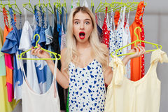 Choosing between two clothes Royalty Free Stock Photo