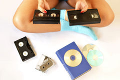 Choosing between two video cassettes Royalty Free Stock Image