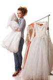 Choosing wedding dress Royalty Free Stock Photos