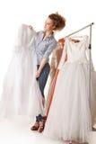 Choosing wedding dress Royalty Free Stock Images