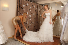 Choosing wedding dress Stock Photo