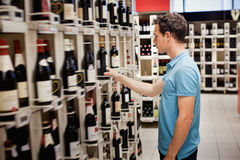 Choosing wine. In the shop Royalty Free Stock Image