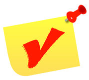Choosing yes. Red check mark on thumb tacked note Stock Image