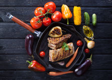 Chop on the bone grill pan Royalty Free Stock Images